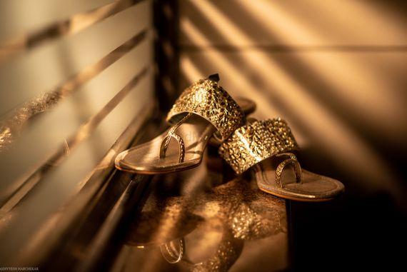 Photo of Gold flat Kolhapuri chappals