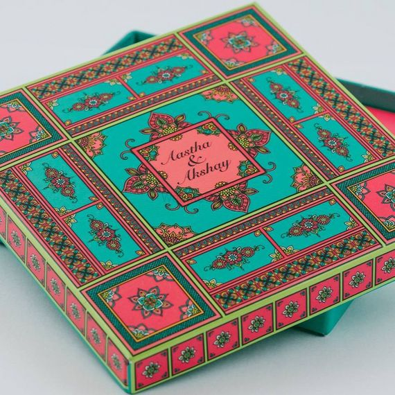 Photo of Teal and pink theme wedding invite box