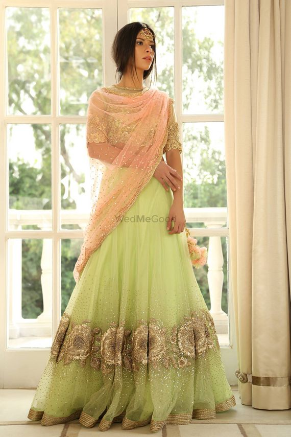 Photo of Light green and peach sequin work lehenga