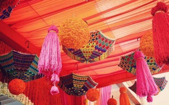 Photo of Pretty decor tassels, hanging genda balls and umbrella