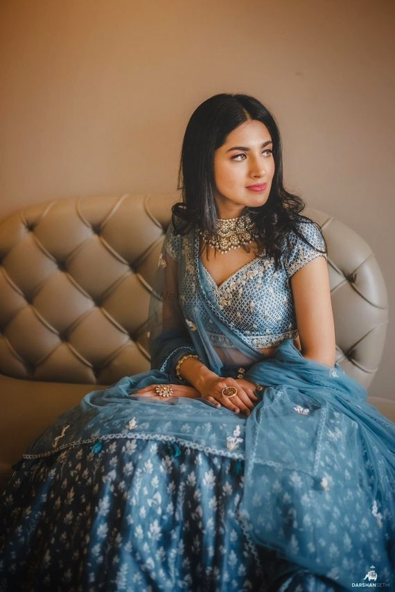 Photo of engagement lehenga in blue with light jewellery