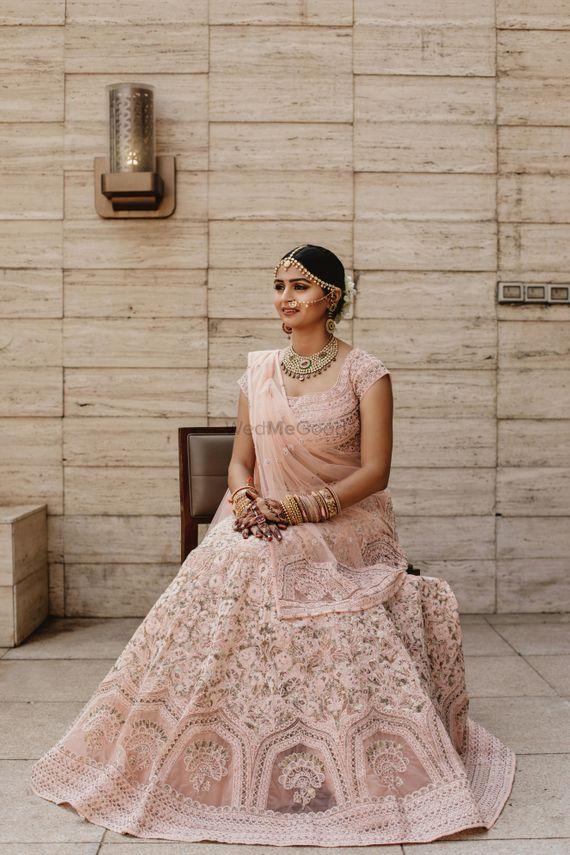 Photo of Pastel bridal lehenga in blush pink