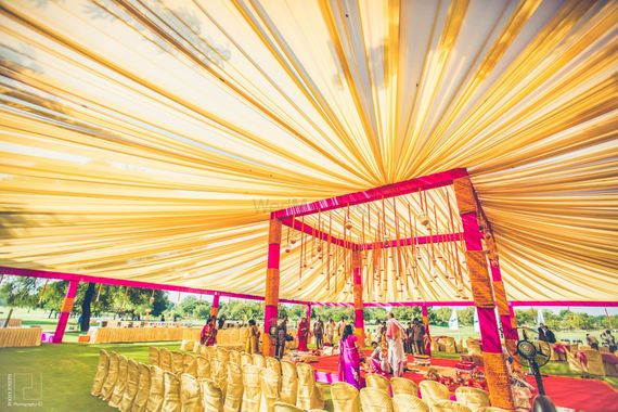 Photo of Gold Canopy and Pink Mandap Decor with Kaleere
