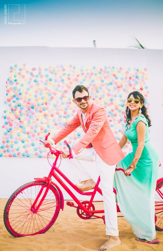Photo of Colourful Pre Wedding Shoot with Cycle and Balloon Wall