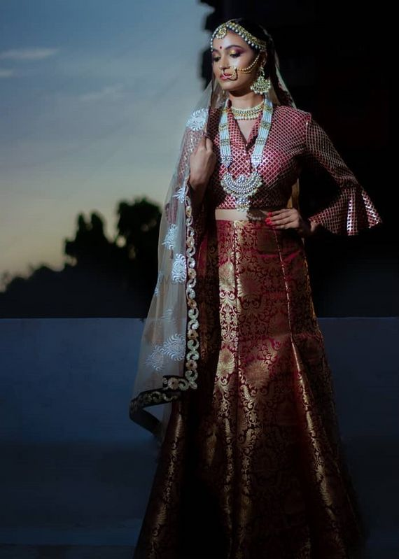 Photo of Pretty red and golden bridal lehenga with bell sleeves blouse for wedding