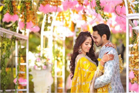 Photo of Mehendi couple shot yellow lehenga