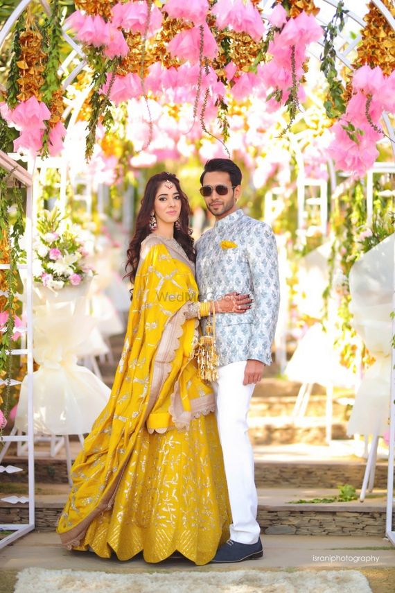 Photo of Yellow lehenga mehendi couple shot
