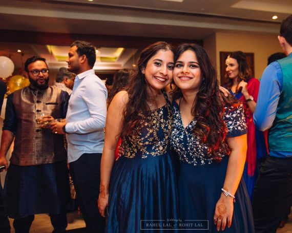 Photo of Bridesmaids wearing matching blue gowns