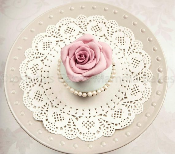 Photo of rose frosting cupcake