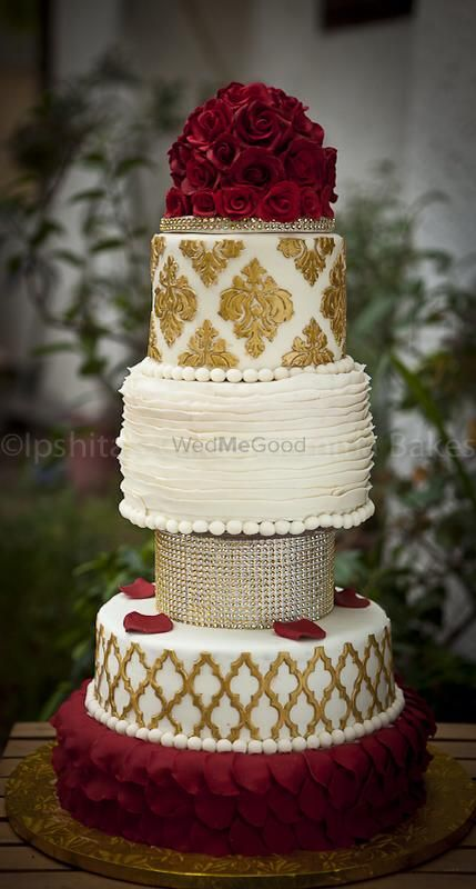 Photo of red and gold wedding cake