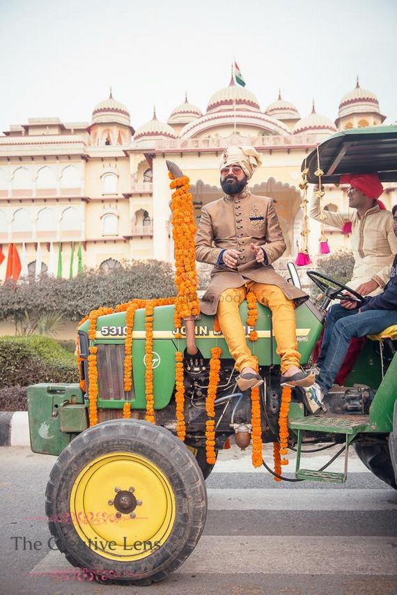 Photo of Groom entering sitting on a tractor
