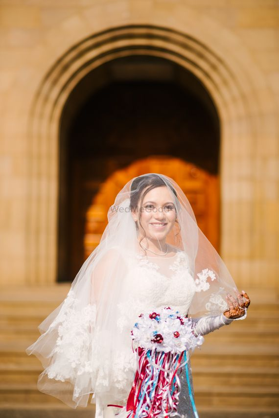 Photo of A christian bride with a veil and a bouquet