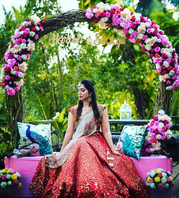 Photo of bridal portrait on mehendi sitting on personalised mehendi seat
