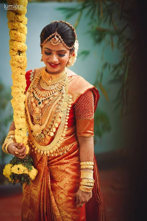Photo Of A South Indian Bride With Gold Temple Jewellery