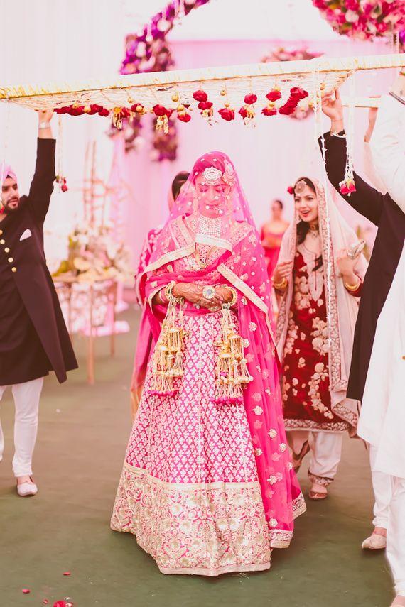 Photo of bright pink bridal lehenga