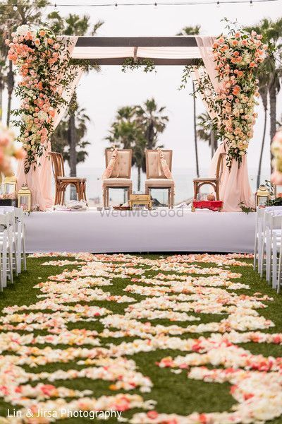 Photo of A floral walkway leading upto a floral mandap setup