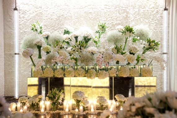 Photo of White and green floral installation at reception