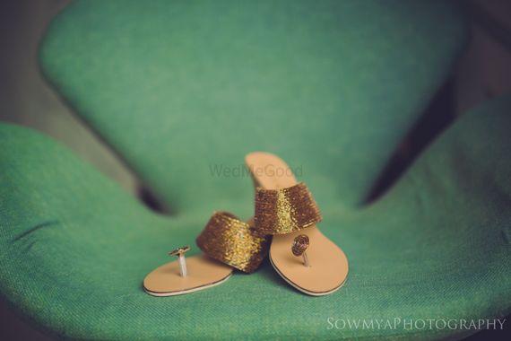 Photo of Flat gold bridal shoes