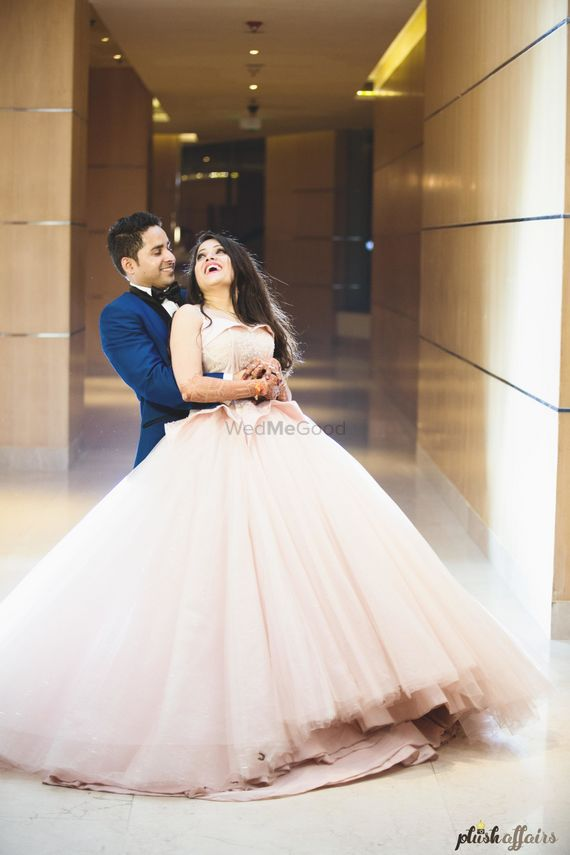 Photo of Blush pink flared engagement gown