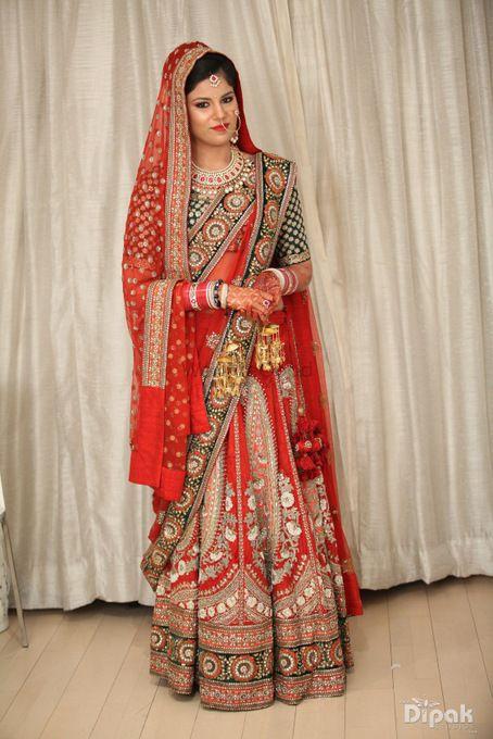 Photo of red bridal lehenga by Sabyasachi. Red velvet lehenga