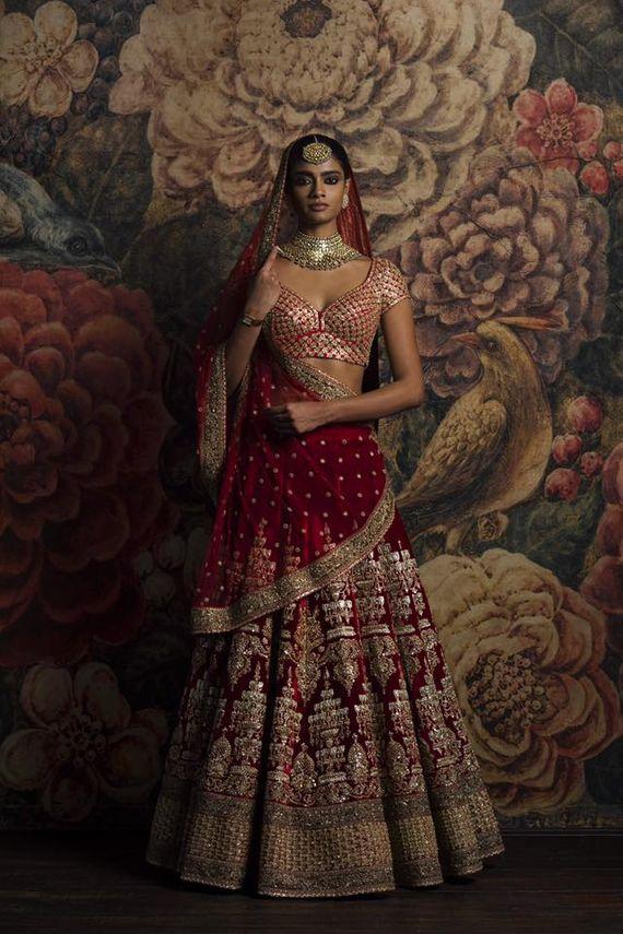 Photo of Sabyasachi maroon velvet bridal lehenga
