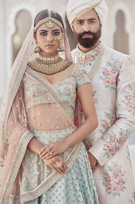 Photo of Sabyasachi mint blue and rose gold bridal lehenga and sherwani