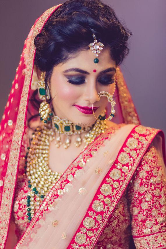 Photo of Bold bridal makeup with smokey eyes