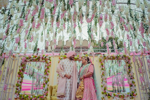 Photo of Pastel couple and decor with floral strings