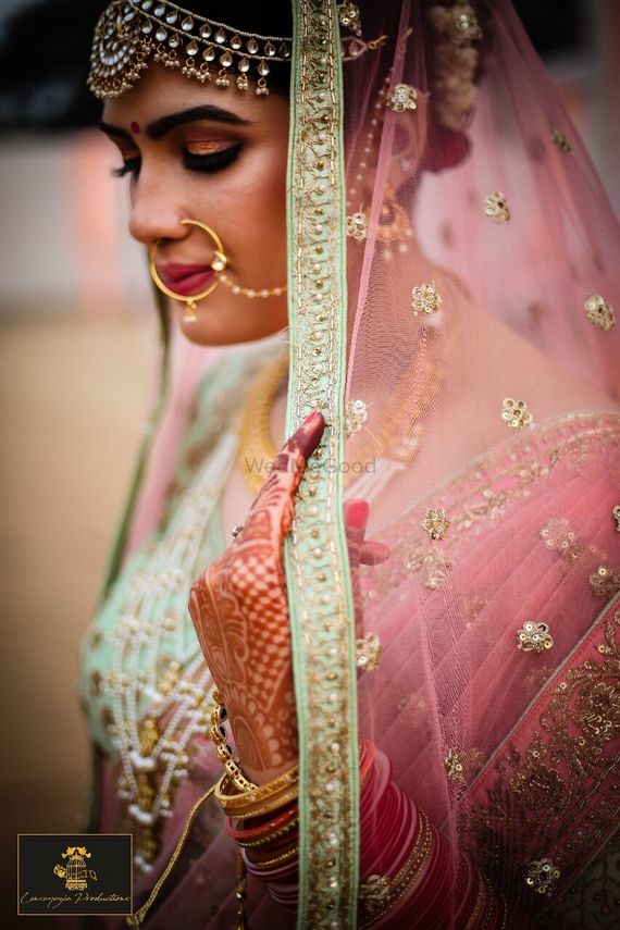 Photo of Light pink and mint bridal lehenga dupatta combination