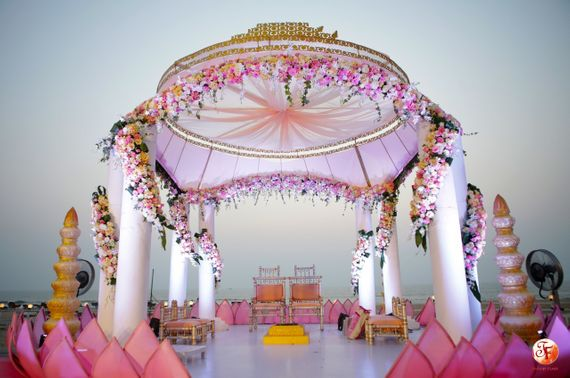 Photo of Simple white and pink mandap in open