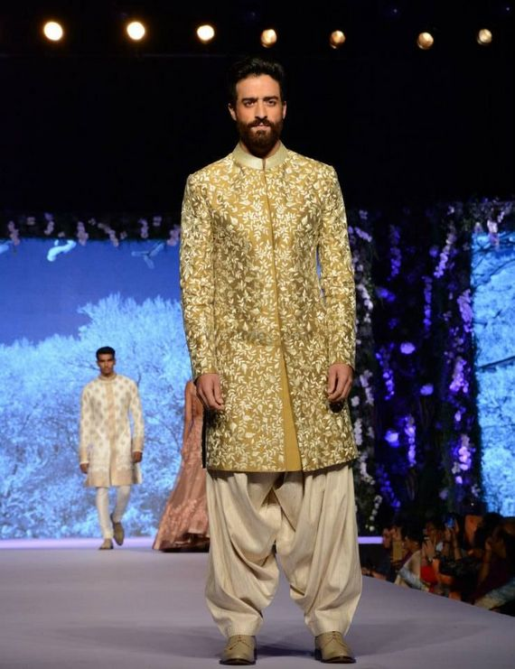 Photo of olive gold and green sherwani and dhoti