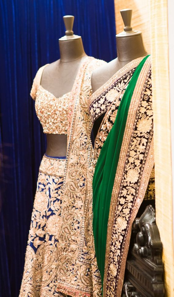 Photo of manish malhotra cream and blue lehenga