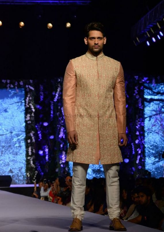 Photo of beige and peach sherwani with churidar