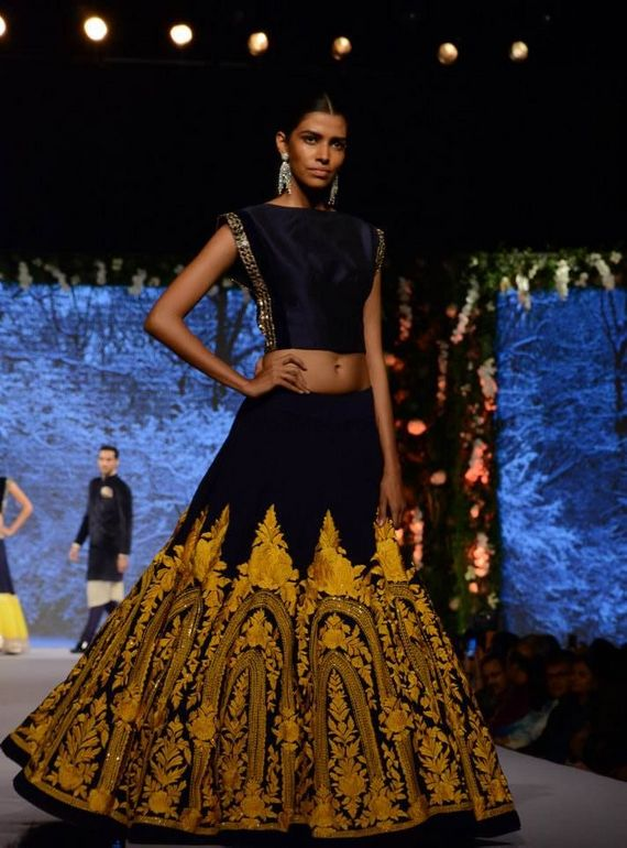 Photo of dark blue and yellow lehenga with crop top
