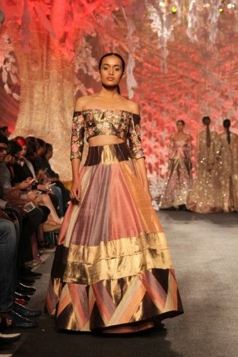 Photo of off shoulder blouse with silk lehenga by Manish Malhotra