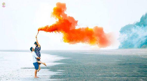 Photo of Pre wedding shoot with orange smoke bomb