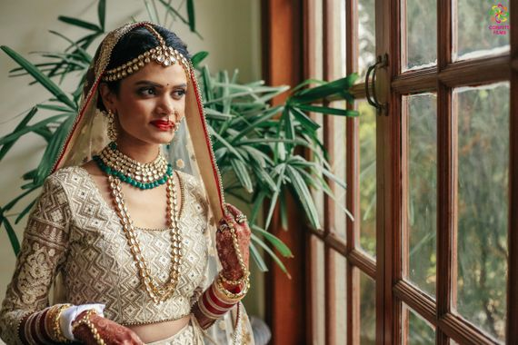 Photo of Offbeat bride in off white and gold lehenga