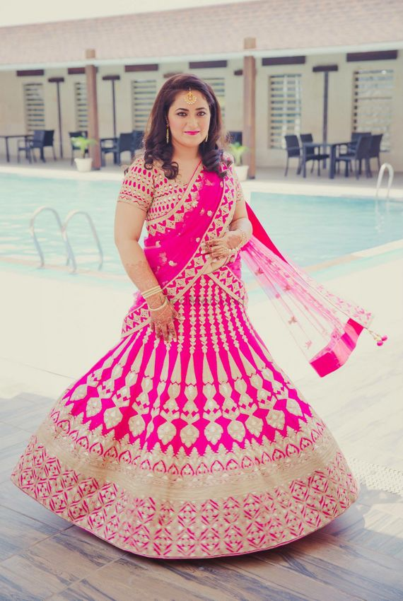 Photo of bright pink gota patti bridal lehenga in raw silk