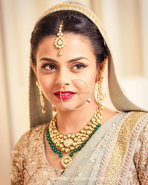 Photo of Gold kundan bridal jewellery with green beads