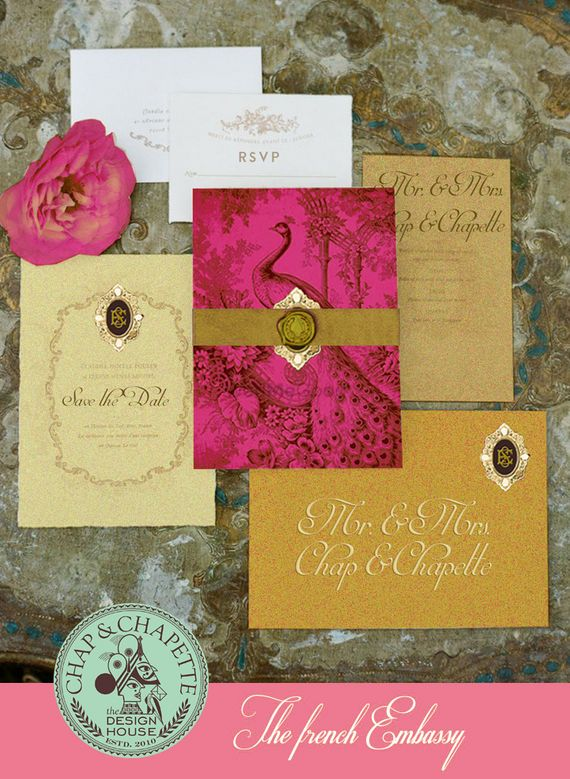 Photo of Pink and gold theme wedding card with peacock motif