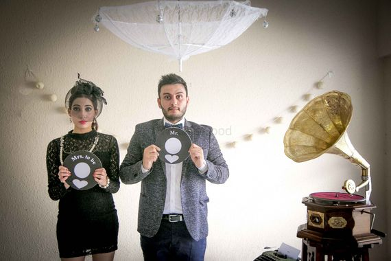 Photo of Fun vintage pre wedding shoot with props