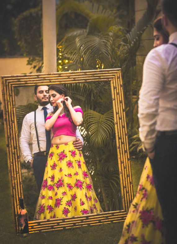Photo of Pre wedding shoot with mirror and yellow floral lehenga