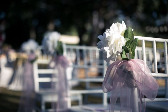 Photo of Chair decor idea with light pink cloth and white flower