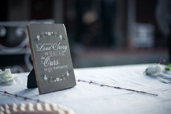 Photo of Frame on table top with cute saying