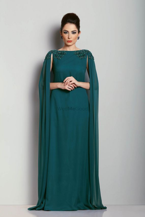 Photo of Teal evening gown with shoulder embroidered cape