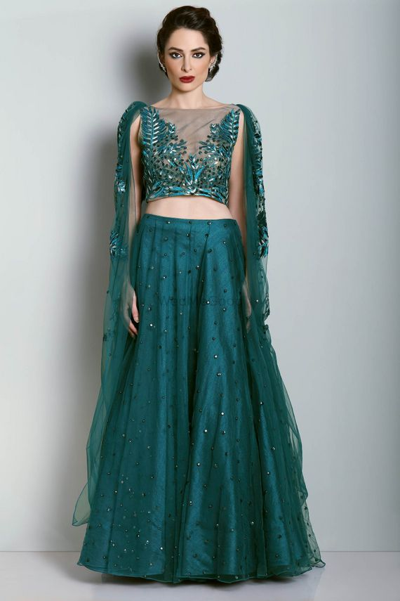 Photo of Teal light lehenga with shoulder embroidered cape