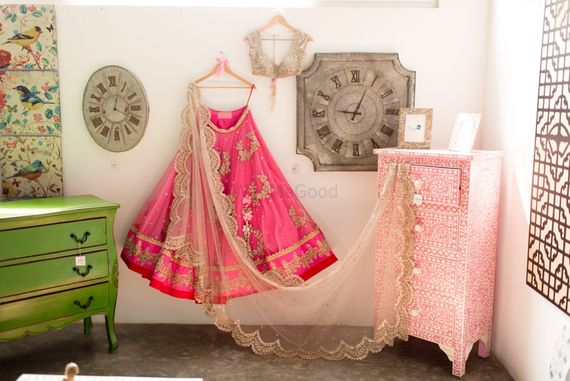 Photo of bright candy pink lehenga for sangeet or engagement in net with large motif