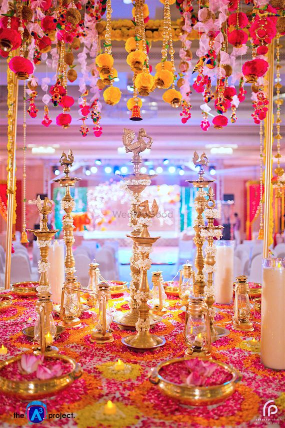 Photo of Yellow and pink theme entrance decor idea with flowers and lamps