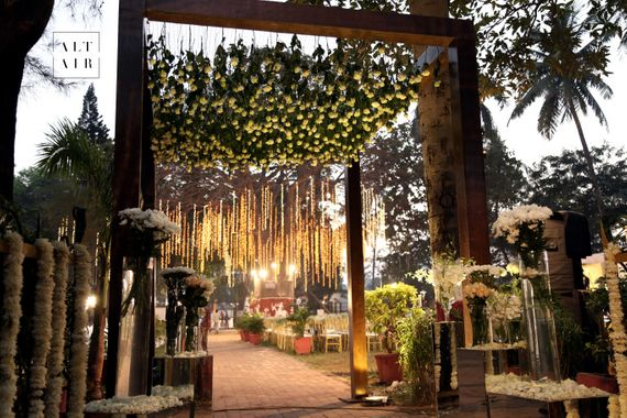 Photo of hanging floral strings reception decor