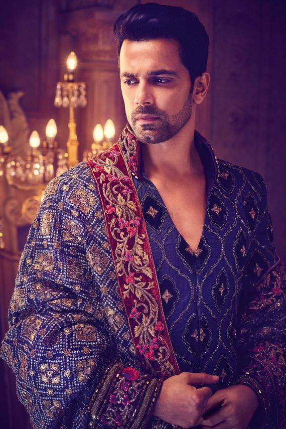Photo of Blue and maroon sherwani with velvet border and zardozi work